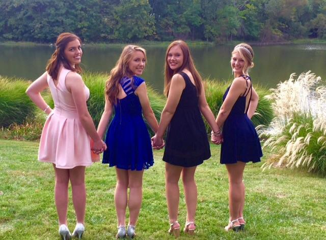 Jacqueline Gallagher, Alyssa Taylor, Sarah Locke, and Sarah Hacker taking pictures before the dance.