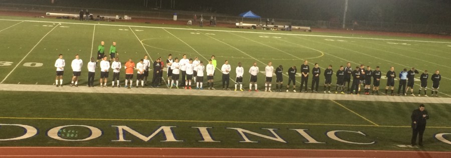 Father Nord praying before the game.