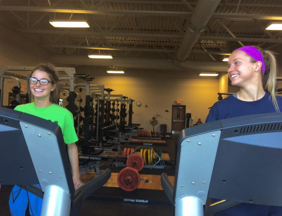 Seniors Mary Maloney and Madeline Bauer working out together