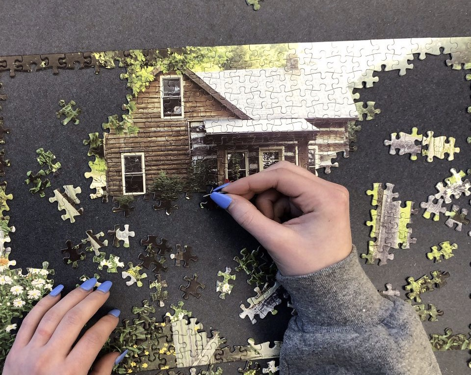 Members of puzzle club working hard to create a masterpiece