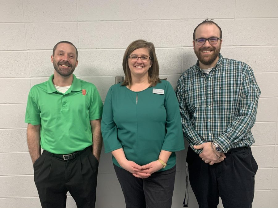 Mr. Asher (left), Ms. Hampton (middle), Mr. Winklemann right) all wearing their green shirts this Tuesday