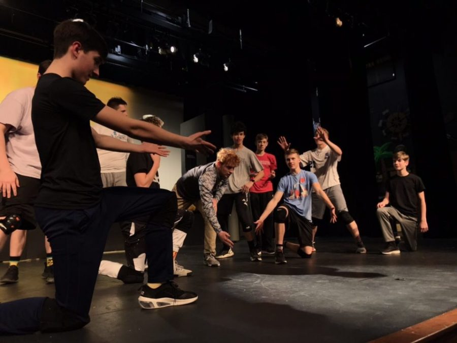 "The boys of ""Guys & Dolls"" practice their choreography in preparation for opening night."