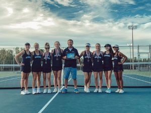 Coach Borst has been leading the tennis team to many victories these past three years.