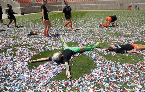 The Houston Dash celebrate after winning their summer tournament in the first successful professional sports bubble.