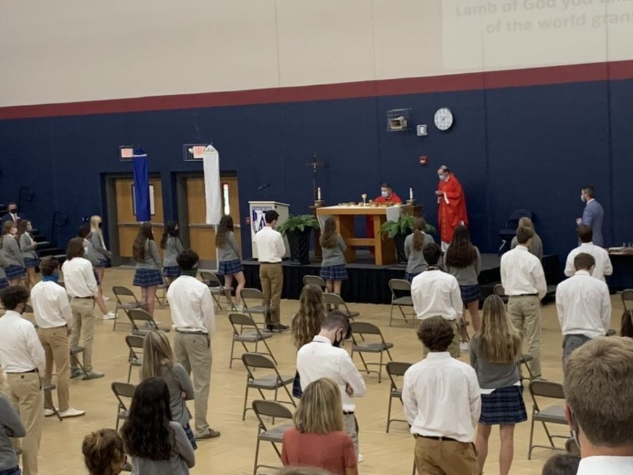 Senior students are social distancing while standing for the Eucharistic prayer