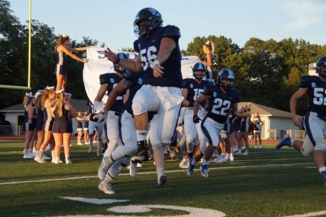 Senior Colin Quain runs out on the field fired up for his upcoming game