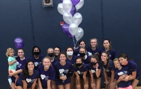 The varsity volleyball team worked hard to prepare a great night for Carson Burroughs