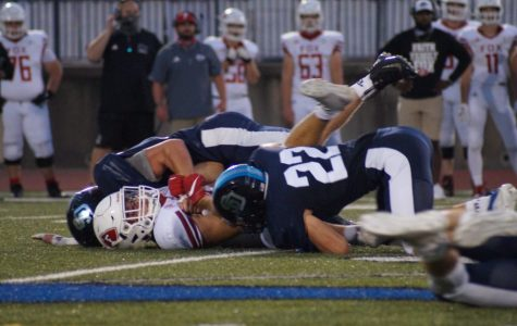 Senior Knoll Hirtz(22)takes the tackle stopping Fox from scoring on Friday night.