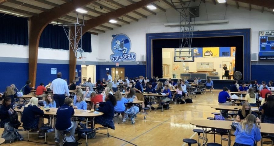 Underclassmen socialize and eat with friends during the new lunch schedule