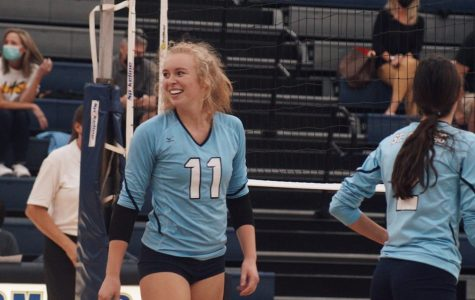 Senior Audrey Weber looks back on her team with a proud smile