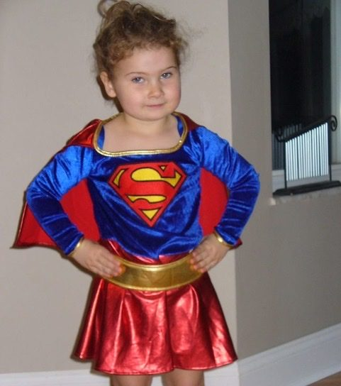 Junior McKinley Curran dresses up as Supergirl ready to save herself some candy