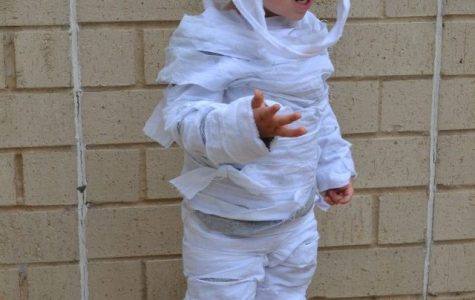 Little boy models an easy at home mummy a Halloween Costume.