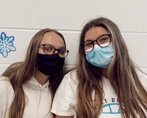Two St. Dominic students, Abby Obert (Left) and Mckinley Curran (Right), correctly wear masks.