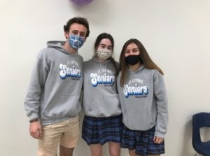 From left to right: Will Nicholson (student body president), Claire Sullivan (peer minister), Emily Marut (family captain)