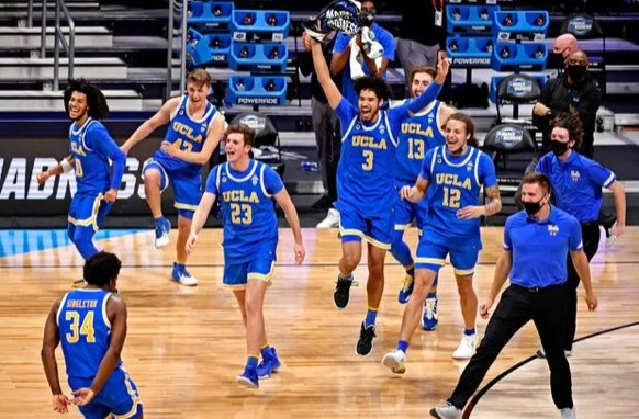 No. 11 UCLA celebrates after beating No. 2 Alabama, continuing their Cinderella Story into the Elite Eight.