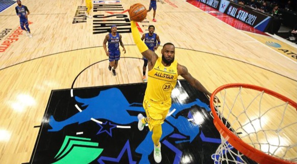 LeBron James goes for a slam dunk during the 2021 NBA All Star Game.