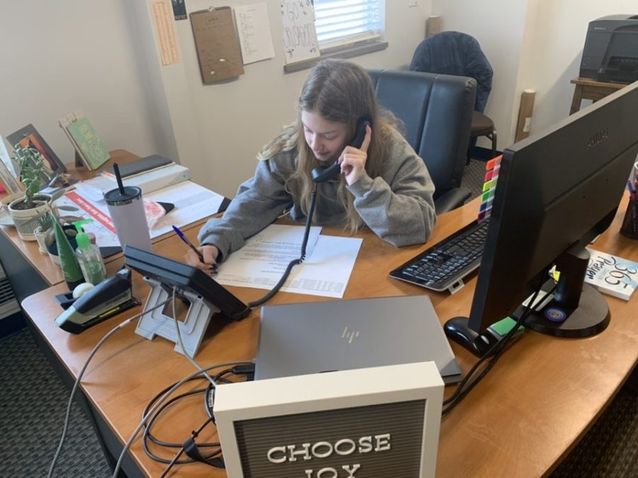 Junior Maddie Poropat calls and thanks one of St. Dominic's donors.