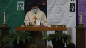 Father Patrick Russell celebrates the Eucharist at the last mass of the school year.
