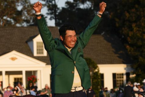 Hideki Matsuyama celebrates after becoming the first golfer from Japan to win the Masters.