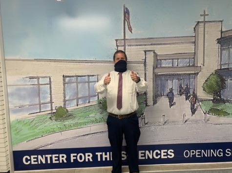 Dean of students Mr. Tock loves to remind kids about the outside weather before lunch.