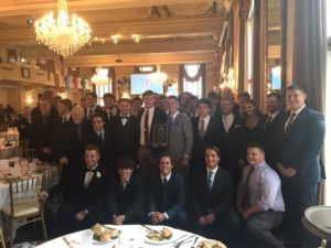 The varsity football team was named Program of the Year at the St. Louis National Football Foundation Banquet and two other awards were given to Coach Markway and Gabe Serri.