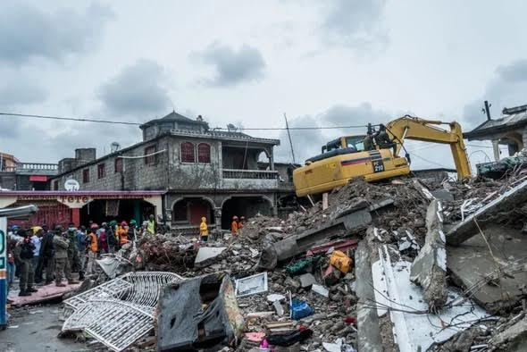 Bulldozer clears rubble left over after earthquake