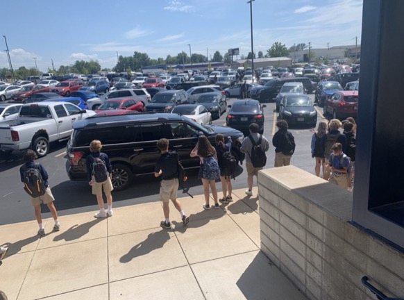 A snapshot of the chaos that ensues in the parking lot after school